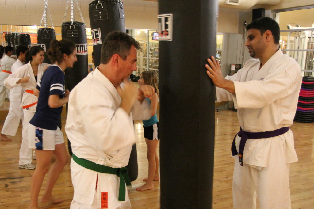 Practicing Heavy-bag Drills at the Full Potential Martial Arts dojo in San Diego